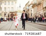 charming couple running in the... | Shutterstock . vector #719281687