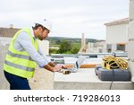 handsome young man foreman... | Shutterstock . vector #719286013