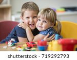little caucasian blonde brother ... | Shutterstock . vector #719292793