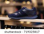 men's shoes in the shop | Shutterstock . vector #719325817