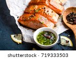 delicious fried salmon fillet ... | Shutterstock . vector #719333503
