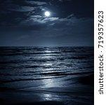 Moon In Night Sky Over Moonlit...