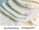 Small photo of Closeup slices of brined cheese