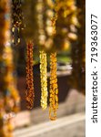 Small photo of Beads from Amber in amber light.