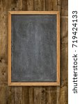 empty blackboard on rustic... | Shutterstock . vector #719424133