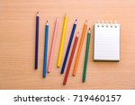 notepad with pencil on wood... | Shutterstock . vector #719460157