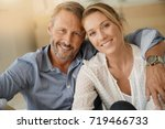 mature couple relaxing at home  ... | Shutterstock . vector #719466733
