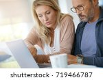 mature couple at home working...   Shutterstock . vector #719466787