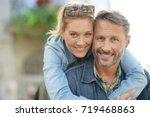 man giving piggyback ride to... | Shutterstock . vector #719468863