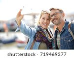 couple of tourists on vacation... | Shutterstock . vector #719469277