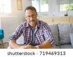 portrait of mature man with... | Shutterstock . vector #719469313