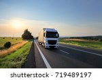truck transportation at sunset | Shutterstock . vector #719489197