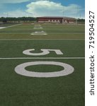 Small photo of The view from the fifty yard line on an astroturf football field.