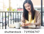 asian woman working on document ... | Shutterstock . vector #719506747