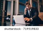 happy businessman working on... | Shutterstock . vector #719519833