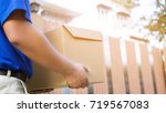 parcel delivery man of a... | Shutterstock . vector #719567083