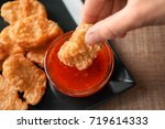 person dipping chicken nugget... | Shutterstock . vector #719614333