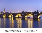czech republic prague - illuminated charles bridge at dusk in winter - stock photo