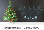 colorful christmas tree on snow.... | Shutterstock . vector #719694097