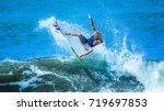 riding the waves. costa rica ... | Shutterstock . vector #719697853