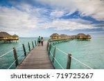 water bungalows in tahiti... | Shutterstock . vector #719725267