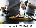 chef working and cooking in the ... | Shutterstock . vector #719741107