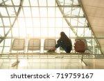 woman in international airport  ... | Shutterstock . vector #719759167