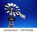 vintage windmill background on...   Shutterstock . vector #719765383