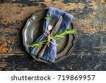 rustic table setting with empty ... | Shutterstock . vector #719869957