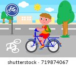 cartoon child riding a bike on... | Shutterstock .eps vector #719874067