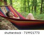 woman relaxing in a hammock | Shutterstock . vector #719921773