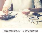 household expenses   woman... | Shutterstock . vector #719923693