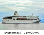 white cruise liner sailing on a ... | Shutterstock . vector #719929993