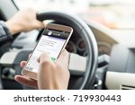 texting while driving car.... | Shutterstock . vector #719930443