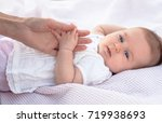 the mother's hand is holding... | Shutterstock . vector #719938693