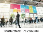 tradeshow visitors rushing in a ... | Shutterstock . vector #719939383