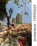Small photo of Sanya, China - April 02, 2017: Garbage dump at a construction site in the tourist city of Sanya
