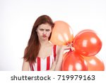 sad woman with balloons on a...   Shutterstock . vector #719979163