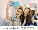 two lovely smiled young women... | Shutterstock . vector #719981677