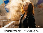 beautiful girl smoking in the... | Shutterstock . vector #719988523