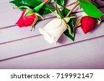 rose flowers on wooden...   Shutterstock . vector #719992147