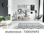 round clock hanging on black... | Shutterstock . vector #720019693