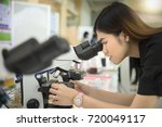 close up. scientist are looking ... | Shutterstock . vector #720049117