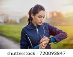 young athlete listening to... | Shutterstock . vector #720093847