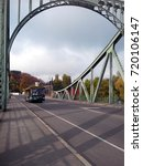 Small photo of POTSDAM, GERMANY - OCTOBER 22, 2016: A city and castle sightseeing tour bus crosses the Glienicke Bridge, also known as the Bridge of Spies.