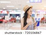 female  check flight on smart... | Shutterstock . vector #720106867