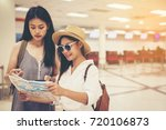 happy women tourist on map to ... | Shutterstock . vector #720106873