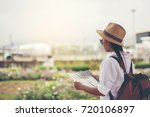 happy women tourist on map to ... | Shutterstock . vector #720106897