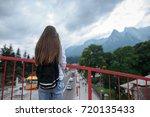 young girl traveler looking at... | Shutterstock . vector #720135433