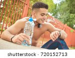 portrait of young man drinking...   Shutterstock . vector #720152713